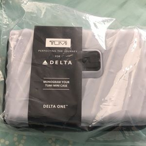 TUMI Hard Case Amenity kit; Delta One